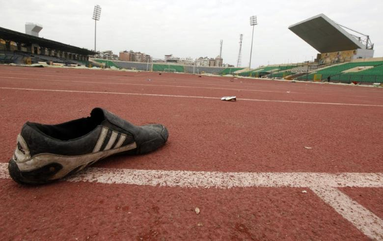 FILE PHOTO: A shoe is seen inside the Port Said stadium one day after soccer supporters clashed  February 2, 2012. REUTERS/Mohamed Abd El-Ghany
