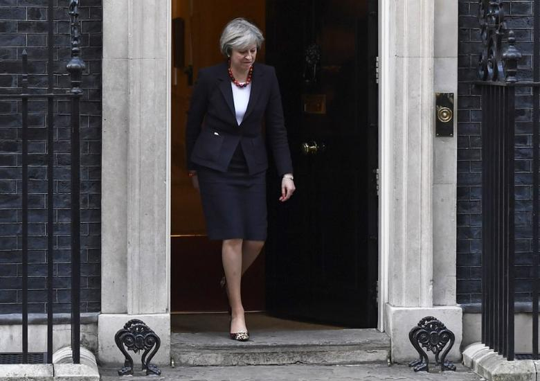 British Prime Minister Theresa May walks to greet her French counterpart Bernard Cazeneuve at Number 10 Downing Street in London, Britain, February 17, 2017. REUTERS/Toby Melville