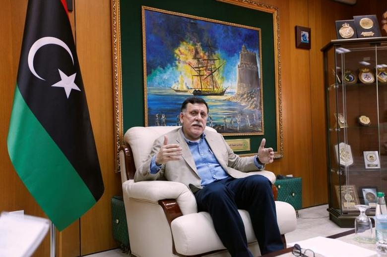 Prime Minister of Libya's unity government Fayez Seraj speaks during an interview with Reuters in his office at the naval base of Tripoli, Libya, June 3, 2016. REUTERS/Ismail Zitouny