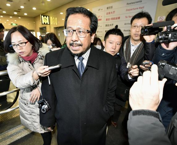 Malaysia's ambassador to North Korea Mohamad Nizan Mohamad (C) is surrounded by media upon his arrival from Pyongyang, after being recalled by Malaysian government, at Beijing airport in Beijing, China, in this photo taken by Kyodo February 21, 2017. Mandatory credit Kyodo/via REUTERS