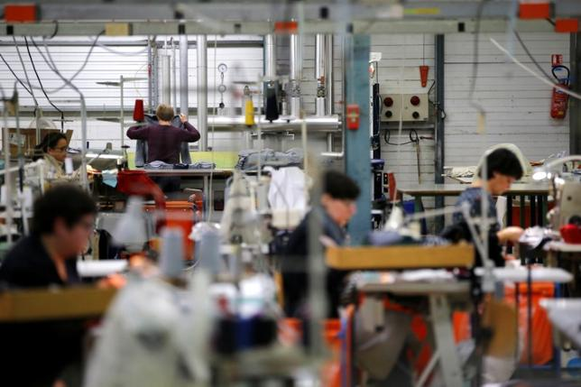 Employees use sewing machines as they work at the Royal Mer Bretagne factory, a specialist in French manufactured knitted clothes, in La Regrippiere, western France, November 28, 2016. REUTERS/Stephane Mahe