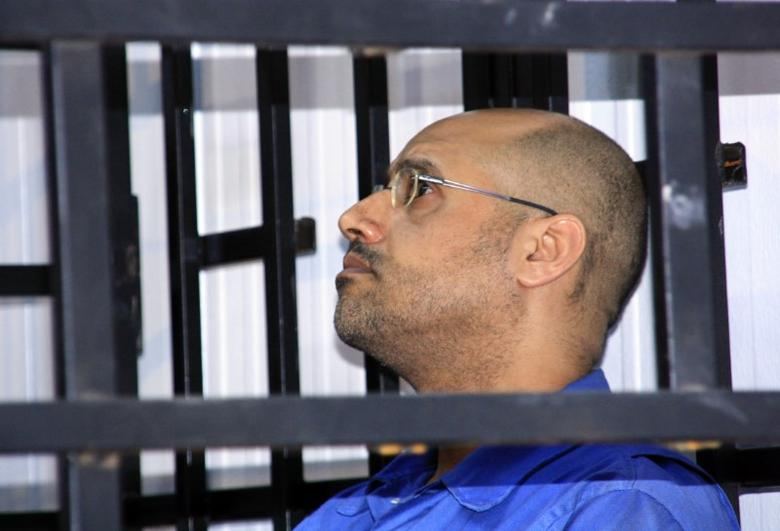 Saif al-Islam Gaddafi, son of late Libyan leader Muammar Gaddafi, attends a hearing behind bars in a courtroom in Zintan May 25, 2014. REUTERS/Stringer