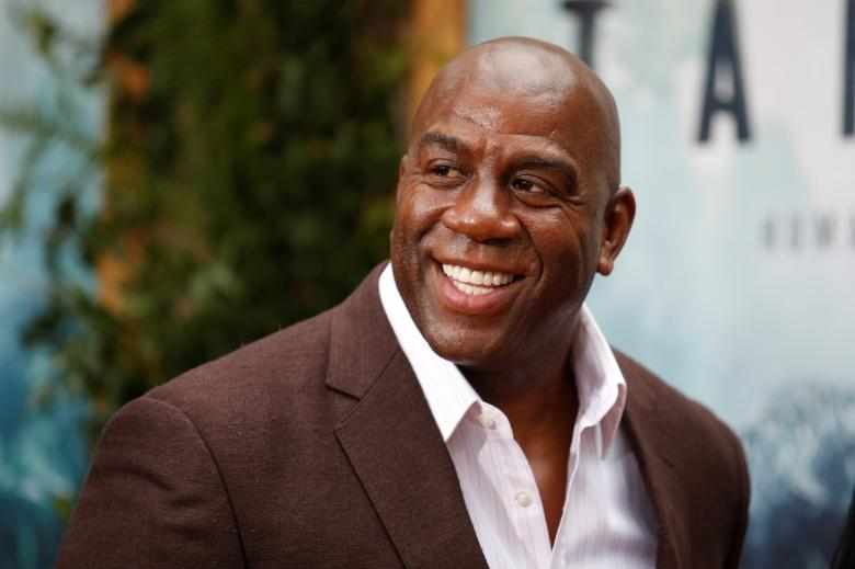 FILE PHOTO - Former NBA basketball player Earvin Magic Johnson poses at the premiere of the movie ''The Legend of Tarzan'' in Hollywood, California, June 27, 2016. REUTERS/Danny Moloshok