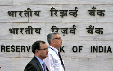 FILE PHOTO: People walk past the Reserve Bank of India (RBI) head office in...