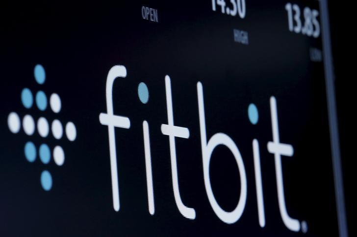 The ticker symbol for Fitbit is displayed at the post where it is traded on the floor of the New York Stock Exchange (NYSE) February 23, 2016. REUTERS/Brendan McDermid