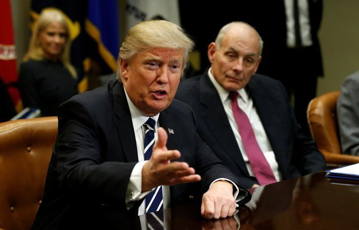 Homeland Security Secretary John Kelly (R) listens to U.S. President Donald Trump during a meeting with cyber security experts in the Roosevelt Room of the White House in Washington January 31, 2017.  REUTERS/Kevin Lamarque