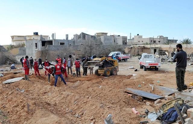 العثور على جثث 13 مهاجرا في حاوية شحن في ليبيا