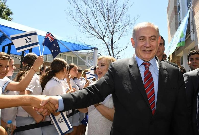 Israeli Prime Minister Benjamin Netanyahu and his wife Sara greet youths during their visit to the Moriah War Memorial College in Sydney, Australia, February 23, 2017. REUTERS/Dean Lewins/Pool