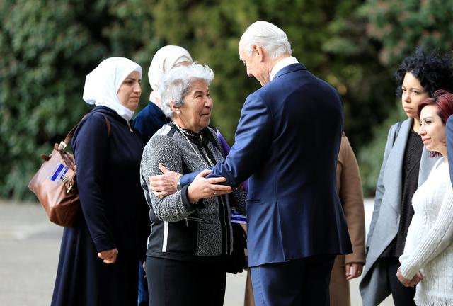 United Nations mediator for Syria Staffan de Mistura meets a group of women whose family members have either been detained by Syrian authorities or abducted by armed groups, or simply missing, outside the United Nations office in Geneva during the Geneva IV conference on Syria, Switzerland, February 23, 2017. REUTERS/Pierre Albouy