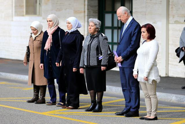 United Nations mediator for Syria Staffan de Mistura and a group of women whose family members have either been detained by Syrian authorities or abducted by armed groups, or simply missing, hold a minute of silence, outside the United Nations office in Geneva during the Geneva IV conference on Syria, Switzerland, February 23, 2017. REUTERS/Pierre Albouy
