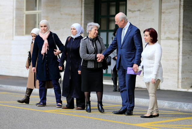 U.N. mediator for Syria Staffan de Mistura meets a group of women whose family members have either been detained by Syrian authorities or abducted by armed groups, or simply missing, outside the United Nations office during the Geneva IV conference on Syria, in Geneva, Switzerland, February 23, 2017. REUTERS/Pierre Albouy