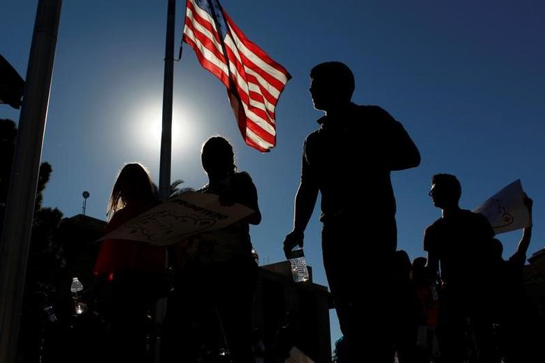 High school students gather in front of the Arizona Capitol in protest against the election of Republican Donald Trump as the president of the United States in Phoenix, Arizona, U.S. November 9, 2016.  REUTERS/Ricardo Arduengo