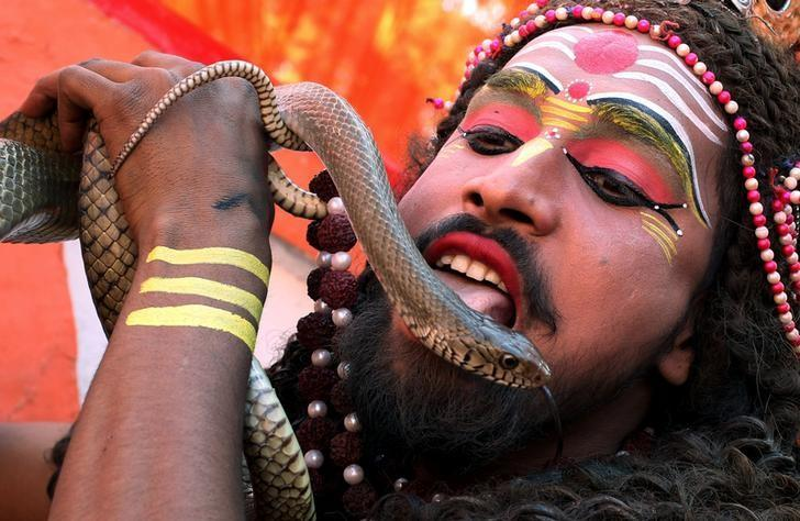 A man dressed as Hindu Lord Shiva performs during a religious procession ahead of the Hindu festival of Maha Shivaratri, in Jammu February 23, 2017. REUTERS/Mukesh Gupta