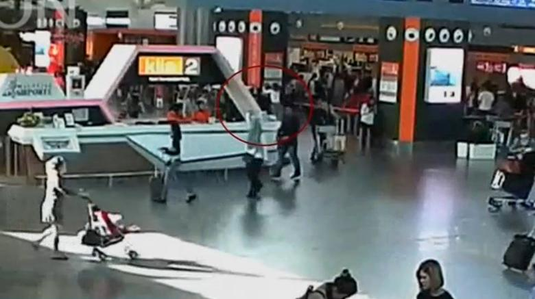 A still image from a CCTV footage appears to show (circled in red) a man purported to be Kim Jong Nam being accosted by a woman in a white shirt at Kuala Lumpur International Airport in Malaysia on February 13, 2017. FUJITV/via Reuters TV