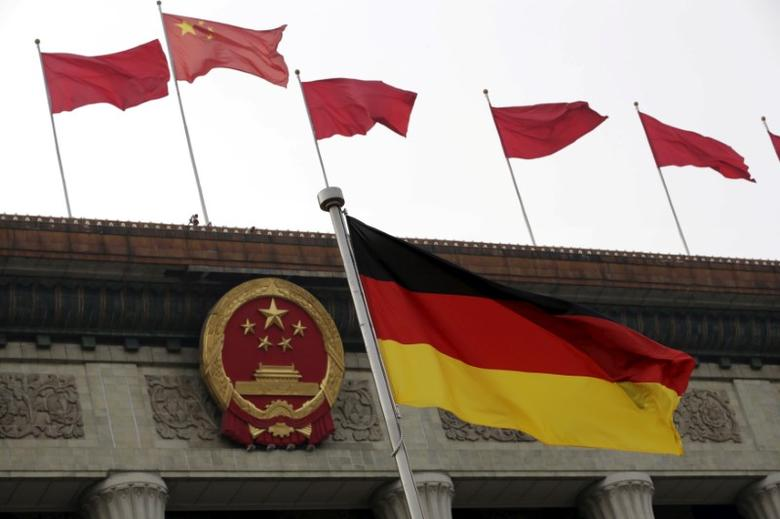 A German flag flutters in front of the Great Hall of the People during a welcoming ceremony for German President Joachim Gauck in Beijing, China March 21, 2016. REUTERS/Jason Lee/File Photo