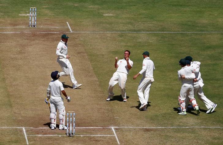 Cricket - India v Australia - First Test cricket match - Maharashtra Cricket Association Stadium, Pune, India - 24/02/17. Australia's Steve O'Keefe celebrates the wicket of India's Ajinkya Rahane. REUTERS/Danish Siddiqui