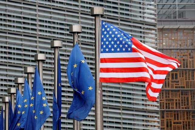 U.S. and European Union flags are pictured during the visit of Vice President Mike Pence to the European Commission headquarters in Brussels, Belgium February 20, 2017. REUTERS/Francois Lenoir/File Photo