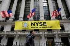 FILE PHOTO: A Snapchat sign hangs on the facade of the New York Stock Exchange (NYSE) in New York City, U.S., January 23, 2017.     REUTERS/Brendan McDermid/File Photo