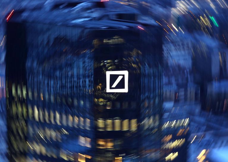 Deutsche Bank board member says staff not quitting over bonus cuts-paper