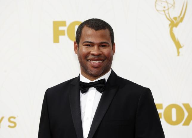 2月26日、バラエティ・ドット・コムによると、週末の北米映画興行収入ランキングは、人種差別をテーマにしたホラー映画「Get Out(原題)」が3050万ドル(約34.2億円)を稼ぎ初登場1位となった。米人気コメディ番組「Key & Peele」で知られるジョーダン・ピール氏(写真)の長編監督デビュー作。写真は2015年9月撮影(2017年 ロイター/Mario Anzuoni)