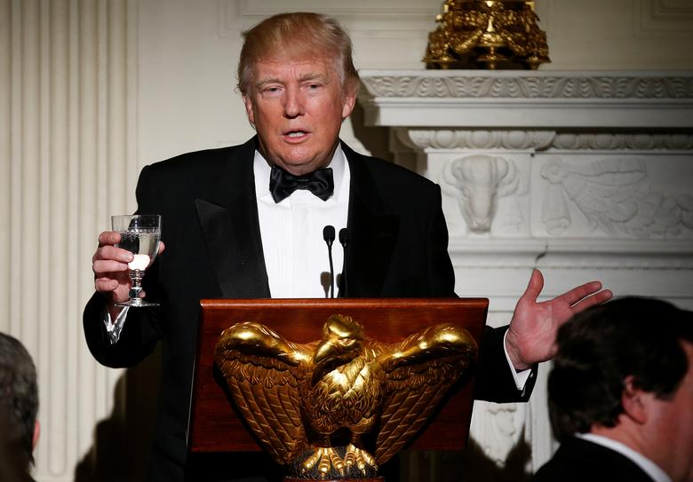 U.S. President Donald Trump makes a toast during the Governor's Dinner in the State Dinning Room at the White House in Washington, U.S., February 26, 2017.   REUTERS/Joshua Roberts