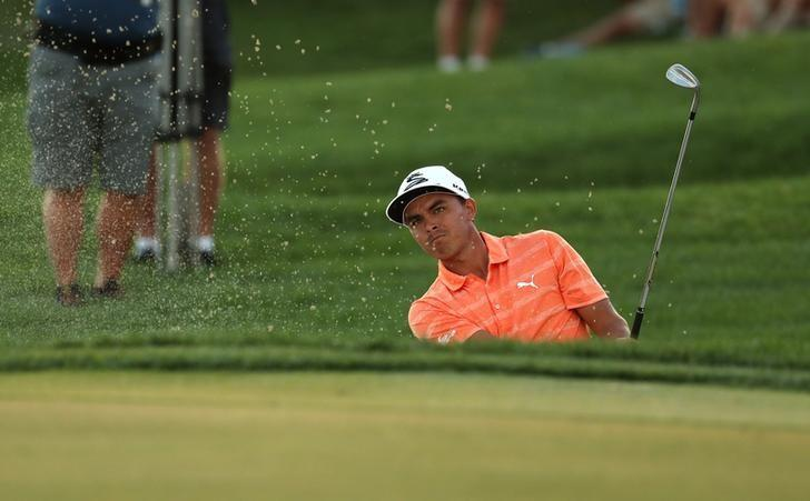 Feb 26, 2017; Palm Beach Gardens, FL, USA; Rickie Fowler hits his third shot out of a bunker on the eighteenth hole during the final round of The Honda Classic at PGA National (Champion). Jason Getz-USA TODAY Sports