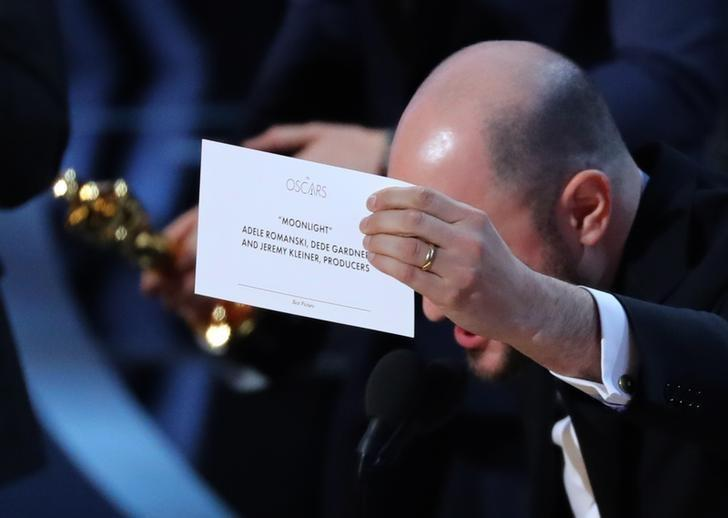 89th Academy Awards - Oscars Awards Show - Producer Jordon Horowitz holds up the card for the Best Picture winner Moonlight. REUTERS/Lucy Nicholson