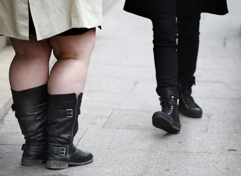 The legs of women are pictured as they walk along a street in Paris, France, October 14, 2015. REUTERS/Jacky Naegelen