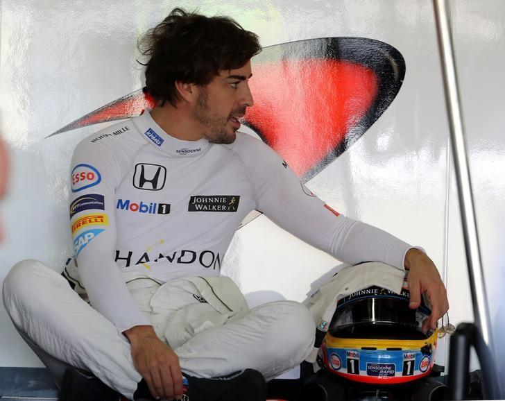 Formula One - F1 - Brazilian Grand Prix - Circuit of Interlagos, Sao Paulo, Brazil - 11/11/2016 - Mc Laren's Formula One driver Fernando Alonso of Spain relaxes in his garage during the first practice session.  REUTERS/Paulo Whitaker