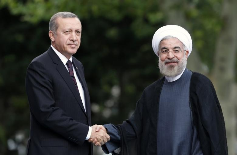 Iran's President Hassan Rouhani (R) is welcomed by Turkey's Prime Minister Tayyip Erdogan as he arrives for a meeting at Erdogan's office in Ankara June 9, 2014. REUTERS/Umit Bektas