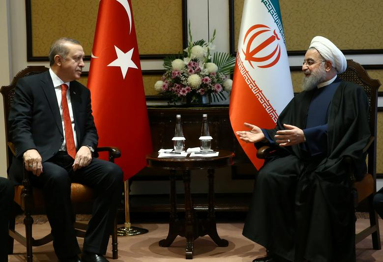 Turkey's President Tayyip Erdogan meets with Iranian President Hassan Rouhani during the 13th Economic Cooperation Organization (ECO) Summit in Islamabad, Pakistan, March 1, 2017. Kayhan Ozer/Presidential Palace/Handout via REUTERS