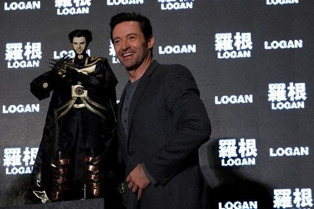 Actor Hugh Jackman poses with a cloth puppet, a traditional type of opera during a news conference during Asian premiere of the X-Men series film 'Logan' in Taipei, Taiwan February 28, 2017. REUTERS/Tyrone Siu