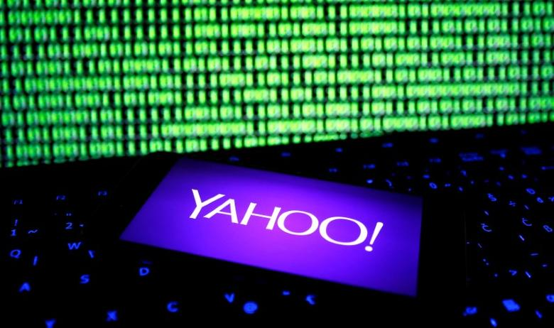 A photo illustration shows a Yahoo logo on a smartphone in front of a displayed cyber code and keyboard on December 15, 2016. REUTERS/Dado Ruvic/File Illustration - RTX2VKYK