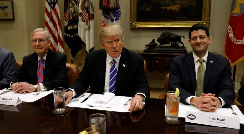 U.S. President Donald Trump hosts a lunch with Senate Majority Leader Mitch McConnell (L) and Speaker of the House Paul Ryan (R) at the White House in Washington, U.S. March 1, 2017.  REUTERS/Kevin Lamarque