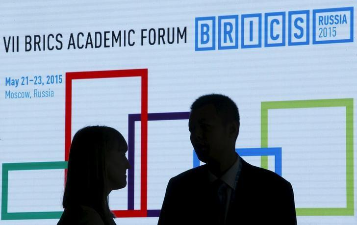Participants speak during the 7th BRICS Academic Forum in Moscow, Russia, May 22, 2015. REUTERS/Sergei Karpukhin/Files