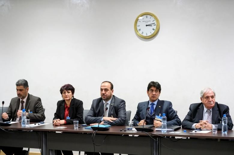 Syria's main opposition delegation with High Negotiations Committee (HNC) leader Nasr al-Hariri (C) attend a meeting with United Nations (UN) Syria envoy during Syria peace in Geneva, Switzerland, February 27, 2017. REUTERS/ Fabrice Coffrini/Pool