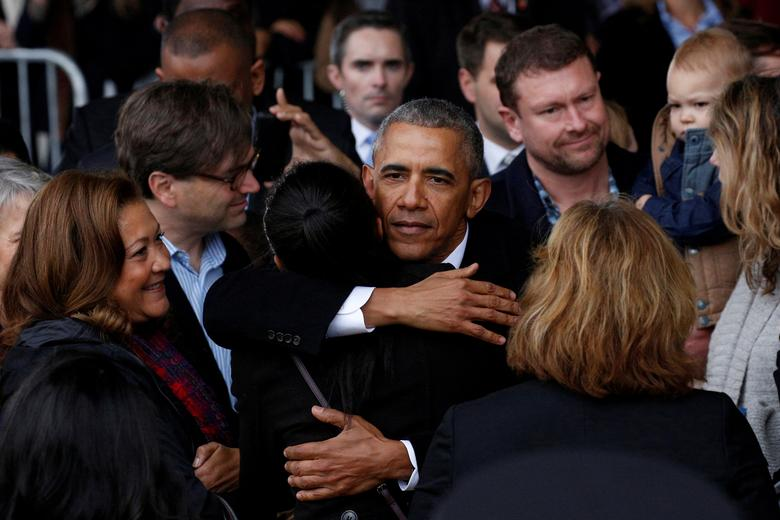 FILE PHOTO - Former president Barack Obama embraces a staff member before boarding Special Air Mission 28000, a Boeing 747 which serves as Air Force One, at Joint Base Andrews, Maryland, U.S. on January 20, 2017.  REUTERS/Brendan McDermid/File Photo