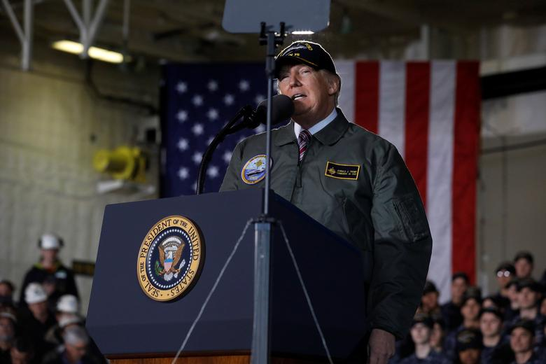 U.S. President Donald Trump delivers remarks aboard the pre-commissioned U.S. Navy aircraft carrier Gerald R. Ford at Huntington Ingalls Newport News Shipbuilding facilities in Newport News, Virginia, U.S. March 2, 2017. REUTERS/Jonathan Ernst