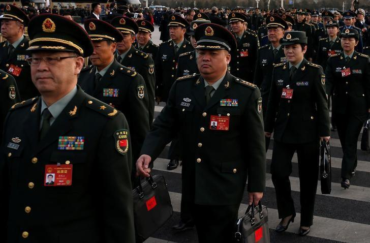 Military delegates arrive ahead of the opening session of the National People's Congress (NPC) outside the Great Hall of the People in Beijing, China, March 5, 2017.  REUTERS/Tyrone Siu