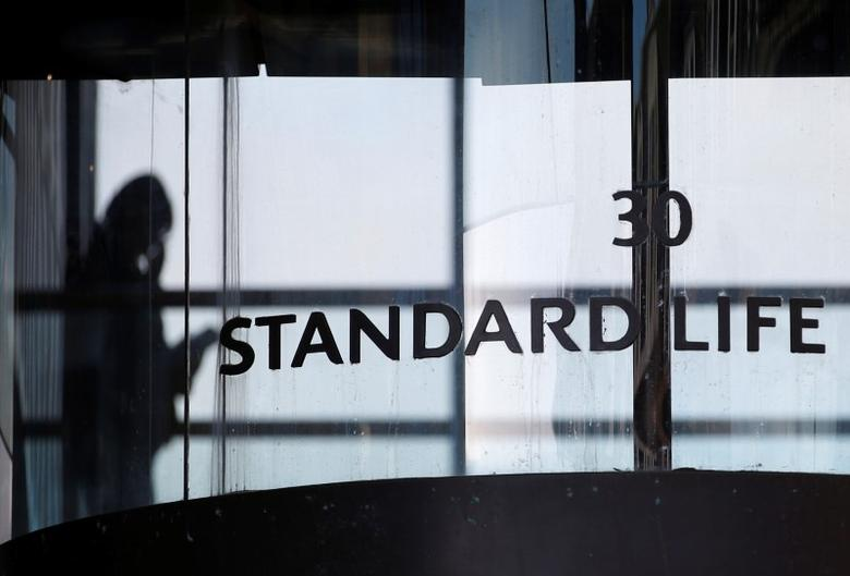 A worker walks inside the Standard Life House in Edinburgh, Scotland February 27, 2014. REUTERS/Russell Cheyne/File Photo