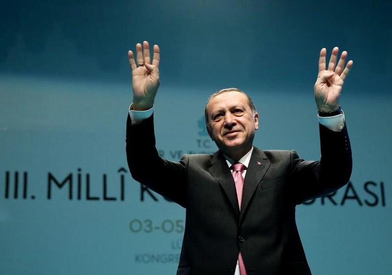 Turkish President Tayyip Erdogan greets the audience during a conference in Istanbul, Turkey, March 3, 2017. Yasin Bulbul/Presidential Palace/Handout via REUTERS