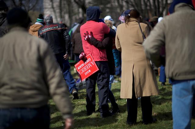 Eric Falco, 32, embraces Alyssa Klingman, 23, while holding a ''Make America Great Again'' sign during a ''People 4 Trump'' rally at Neshaminy State Park in Bensalem, Pennsylvania. REUTERS/Mark Makela