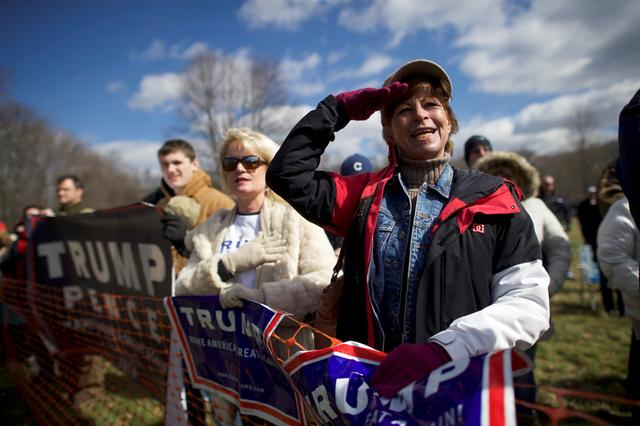 Trump supporter Beth Holz salutes during a ''People 4 Trump'' rally at Neshaminy State Park in Bensalem, Pennsylvania. REUTERS/Mark Makela