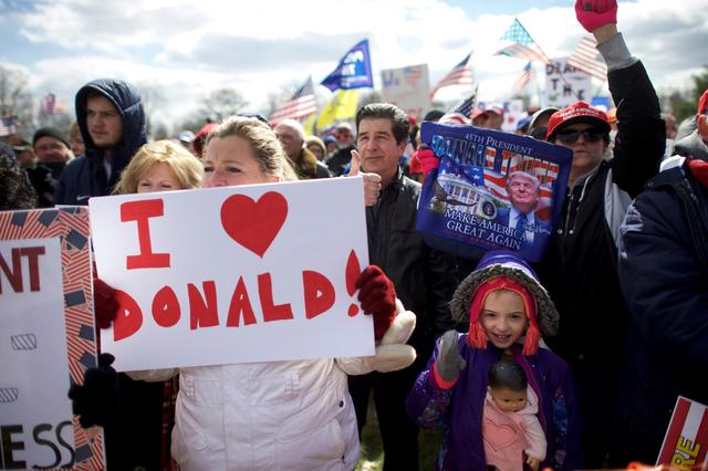 Gia Morris (R), 8, carries a doll while cheering during a ''People 4 Trump'' rally at Neshaminy State Park in Bensalem, Pennsylvania. REUTERS/Mark Makela