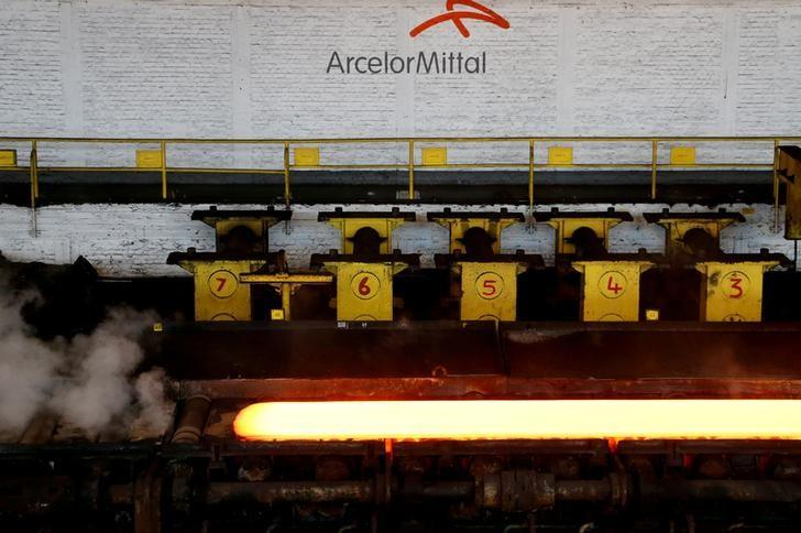 A red-hot steel plate passes through a press at the ArcelorMittal steel plant in Ghent, Belgium, July 7, 2016. REUTERS/Francois Lenoir/File Photo