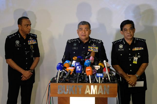 Malaysia's Royal Police Chief Khalid Abu Bakar (C) speaks during a news conference regarding the apparent assassination of Kim Jong Nam, the half-brother of the North Korean leader, at the Malaysian police headquarters in Kuala Lumpur, Malaysia, February 22, 2017. REUTERS/Athit Perawongmetha