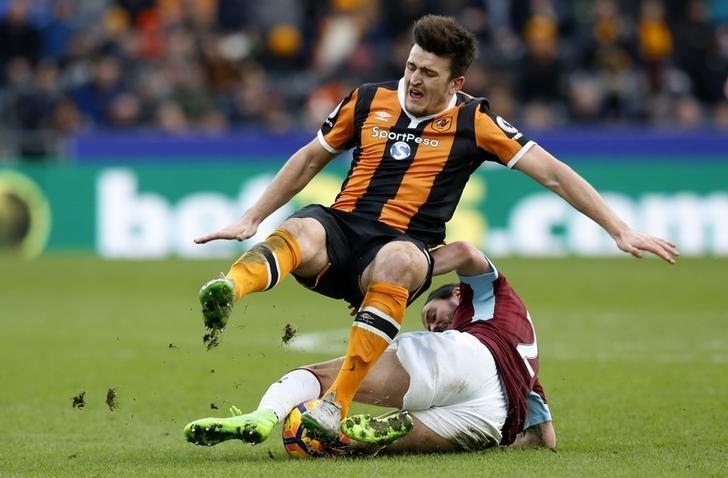 Britain Football Soccer - Hull City v Burnley - Premier League - The Kingston Communications Stadium - 25/2/17 Hull City's Harry Maguire in action with Burnley's George Boyd  Action Images via Reuters / Ed Sykes Livepic