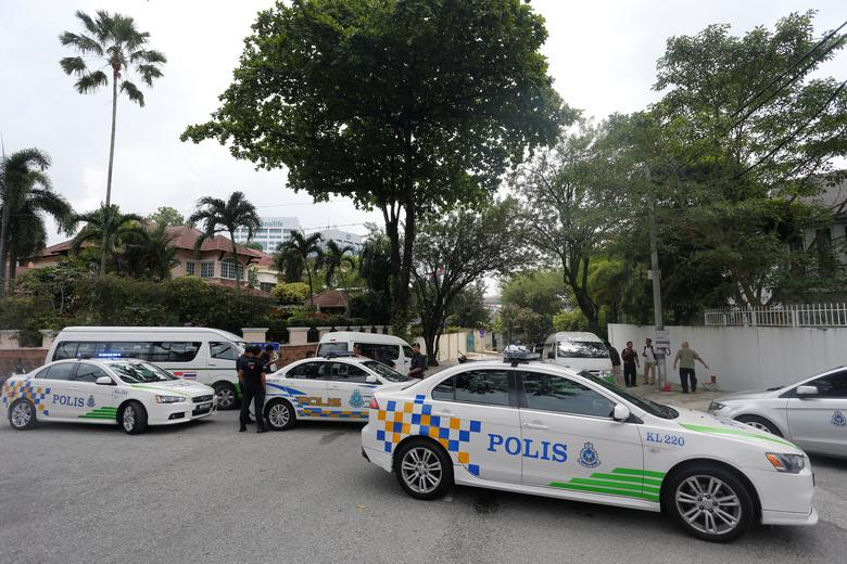 Police cars form a roadblock outside the sealed off North Korea embassy in Kuala Lumpur, Malaysia March 7, 2017. REUTERS/Lai Seng Sin
