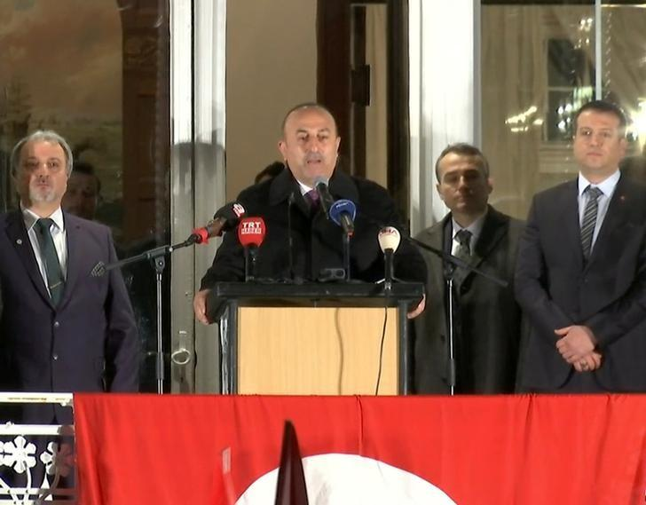 A still image taken from video footage shows Turkish Foreign Minister Mevlut Cavusoglu (C) addressing rally in Hamburg, Germany March 7, 2017, as part of a campaign trip for Turkey's upcoming constitutional referendum.  REUTERS/Reuters TV