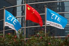 FILE PHOTO: A Chinese national flag and two flags bearing the name of ZTE fly outside the ZTE R&D building in Shenzhen, China April 27, 2016.  REUTERS/Bobby Yip/File Photo